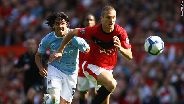 The absence of Nemanja Vidic (right) further depletes Manchester United's defence.