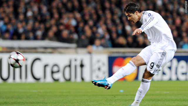 Cristiano Ronaldo powers home his fifth minute free kick in Real's 3-1 win over Marseille.