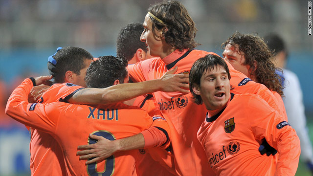 Barcelona players celebrate Xavi's equalizing goal on their way to a vital 2-1 victory at Dynamo Kiev.