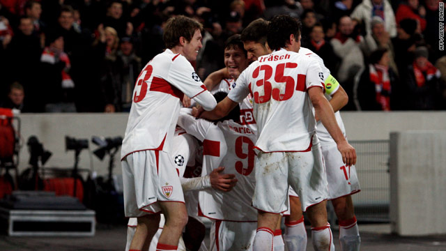 Stuttgart players celebrate scoring their opening goal as they beat Unirea 3-1 to reach the Champions League last 16.