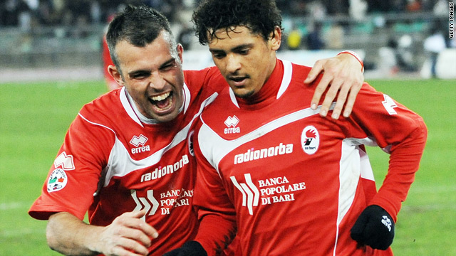 Bari goalscorers Riccardo Meggiorini, left, and Paulo Barreto celebrate after the latter's penalty against Juventus.