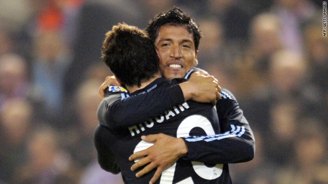 Real hero Ezequiel Garay is congratulated by his compatriot Gonzalo Higuain, who also scored twice.