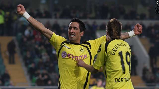 Barrios celebrates his goals as Dortmund ease past Wolfsburg.