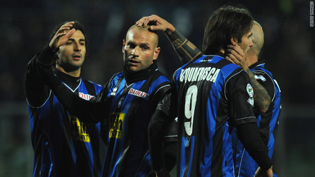 Atalanta celebrate their late equalizer at home to champions Inter Milan.
