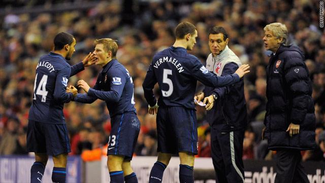 Arsenal manager Arsene Wenger puts his point across as his team celebrate Arshavin's stunning goal.