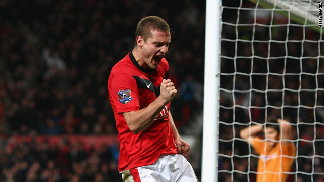 Nemanja Vidic celebrates scoring Manchester United's second goal in their 3-0 victory over Wolves.
