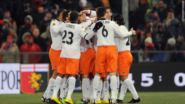 Valencia players celebrate their opening goal in the 2-1 victory at Genoa on Thursday.