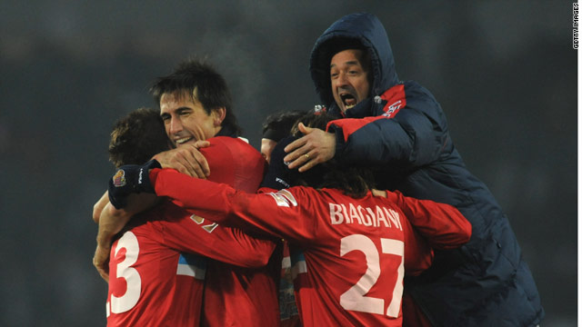 Catania's players celebrate their much-needed victory at Juventus in Serie A.