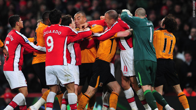 A brawl near halftime at the Emirates has left both clubs facing an FA charge.