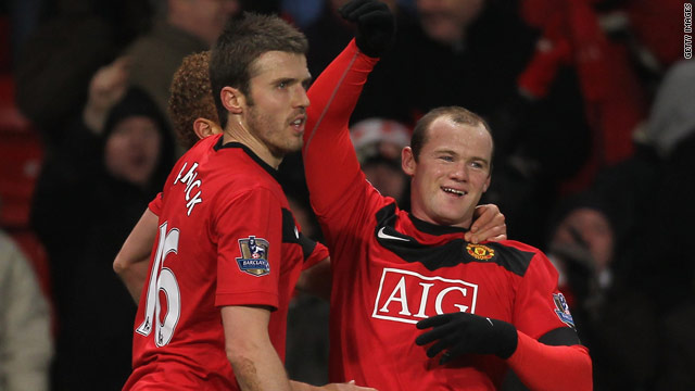 Michael Carrick (left) and Wayne Rooney celebrate one of  Manchester United's goals in their comfortable win.