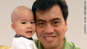 Kevin Shepherdson, with son Daryl, of Singapore discovered he is related to Thomas Kurowski in the United States.