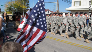 Soldiers march in a Veterans Day parade in Killeen, Texas, near Fort Hood.