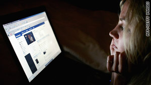 A user looks at Facebook, which is accused of failing to do enough to combat bullying.
