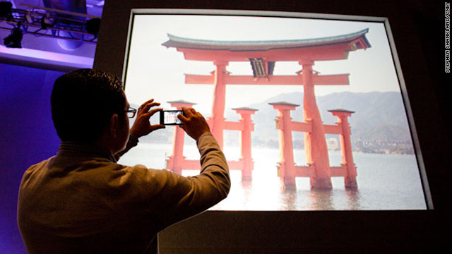 Vic Gundotra of Google takes a photo of the Itsukushima Shrine in Japan. The Google Goggles feature successfully identified it.