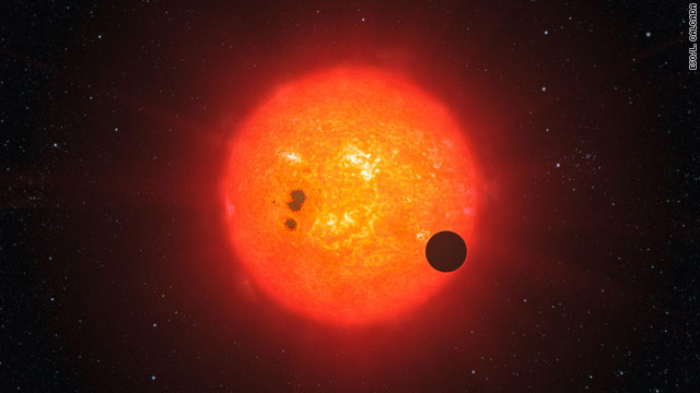 This illustration shows how the newly discovered planet may look orbiting its nearby star, which is smaller than Earth's sun.