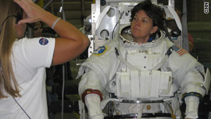 Cady Coleman's spacesuit weighs 300 pounds, more than twice her body weight.