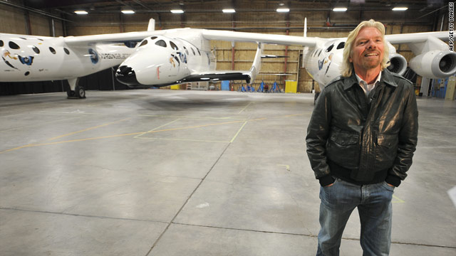 Sir Richard Branson shows off the SpaceShipTwo in a Mojave, California, hangar on Monday.