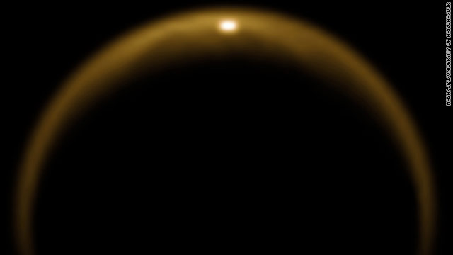 A photo from Cassini shows sunlight reflecting from a giant lake of methane on the northern half of Saturn's moon Titan.