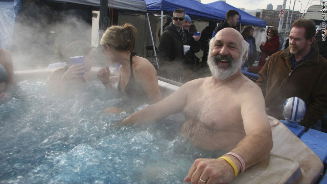 "Joe Cahn, seen here soaking in a hot tub at a Detroit Lions tailgate party, calls himself the ""Commissioner of Tailgating."""