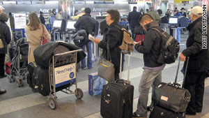 Passengers wait in line Thursday morning at New York's LaGuardia Airport, one of the affected airports.