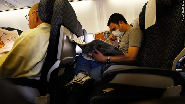 Some airline passengers have been trying to protect themselves from the flu by wearing masks.
