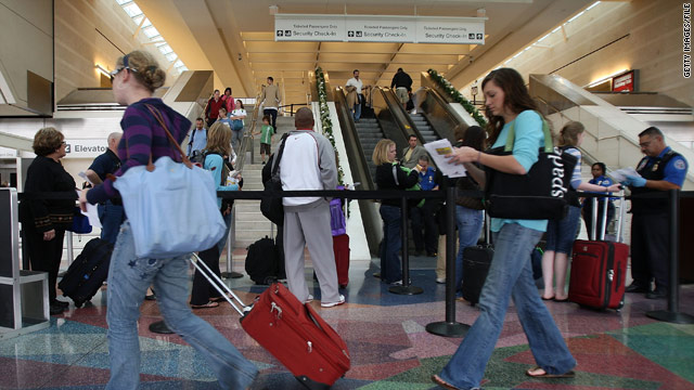 Travelers pass through California's L.A./Ontario International Airport. Thanksgiving travel by air is expected to decline this year.
