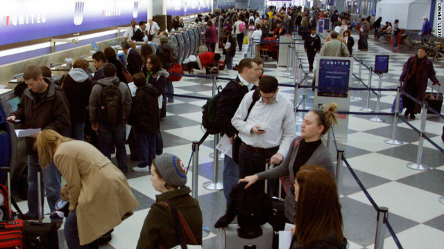 Passengers wait to check in Wednesday at the United Airlines terminal at O'Hare International Airport in Chicago, Illinois.