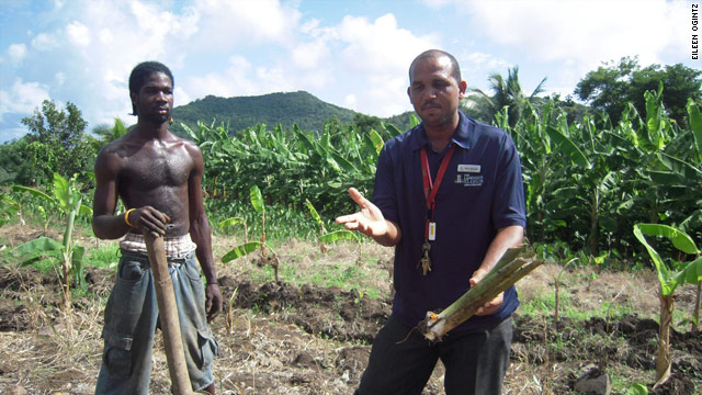 Solomon Chelcher, left, and Isaac Alphonse talk about planting at the Richards Farm in St. Lucia.