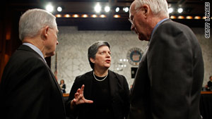 Homeland security chief Janet Napolitano talks with Sens. Jeff Sessions, left, and Patrick Leahy before the hearing.
