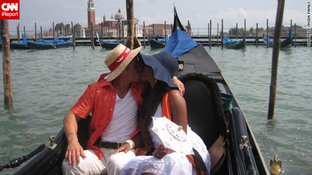Mikolaj Sroda and his wife Loverly Jn Paul share a romantic moment in Venice, Italy.  The couple met while traveling.
