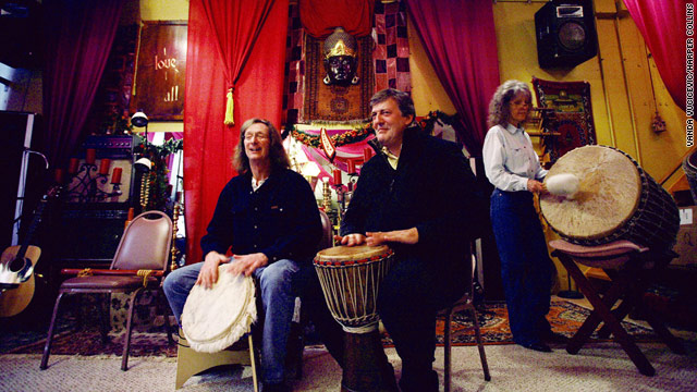 English humorist Stephen Fry, center, drums with Ed and Dianna Peden in their home, a converted missile bunker in Kansas.