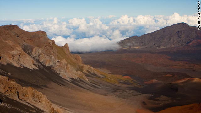 The view from Haleakala, a 10,000-foot cone that presides over Maui, and the volcano that created the West Maui Mountains.