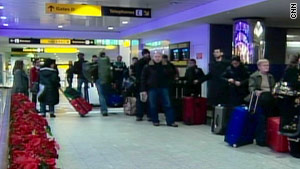 Passengers stranded at LaGuardia airport in New York on Monday.