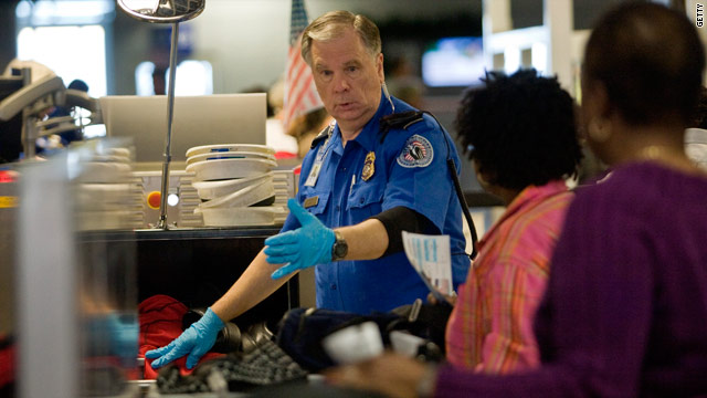 A TSA officer screens airline passengers at Dallas/Fort Worth International Airport December 27, 2009 in Dallas, Texas.