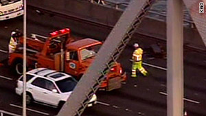 Workers respond to Tuesday's accident caused by debris which fell from the San Francisco Bay Bridge.
