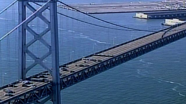Traffic moves again on the San Francisco-Oakland Bay Bridge following final inspections Monday.