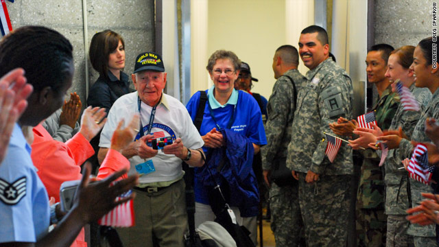 A World War II veteran is greeted in Washington en route to the memorial.