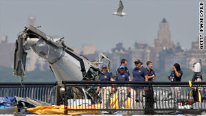 The FBI investigates the remains of the helicopter involved in the August collision that triggered the new rules.