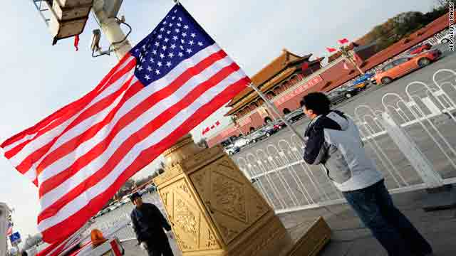 Workers prepare to hoist a U.S. flag on Beijing's Tiananmen Square Monday ahead of U.S. President Barack Obama's visit.