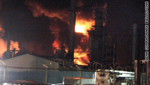 Flames leap from the Caribbean Petroleum depot in October.
