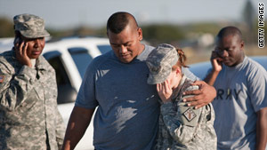 Sgt. Fanuaee Vea, left, embraces Pvt. Savannah Green after shootings outside Fort Hood in Texas.