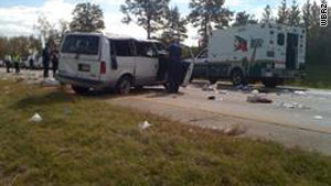 Rescue workers at the scene of a multiple-fatality crash Saturday on I-10 near Baton Rouge, Louisiana.
