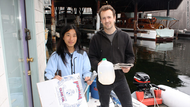 Shannon Cheng and Ethan O'Connor stand on their houseboat with trash they're about to follow on the Web.