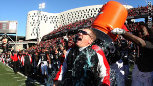 Cincinnati coach Brian Kelly gets a victory soaking after his team's win over Syracuse to claim the 2008 Big East title.