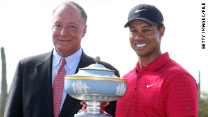 Accenture CEO William D. Green appears with Tiger Woods after a 2008 tournament in Arizona.