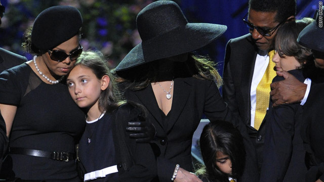 Janet Jackson, left, holds Paris Katherine Jackson, the second of Michael Jackson's three children at her father's memorial service in July.