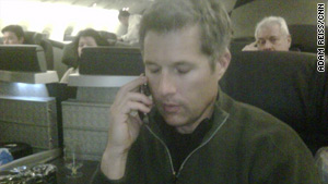 David Goldman appears aboard a jetliner flying to Brazil.