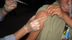 Volunteers vaccinate Lee Engels, a newly homeless man, against H1N1 in Fort Lauderdale, Florida.