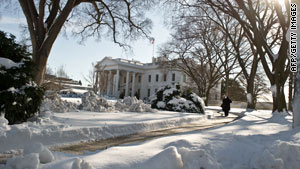 The White House basks under a blanket of picturesque white snow on Sunday.