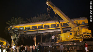 Rescuers search for survivors after a collision between two passenger trains south of Cairo.